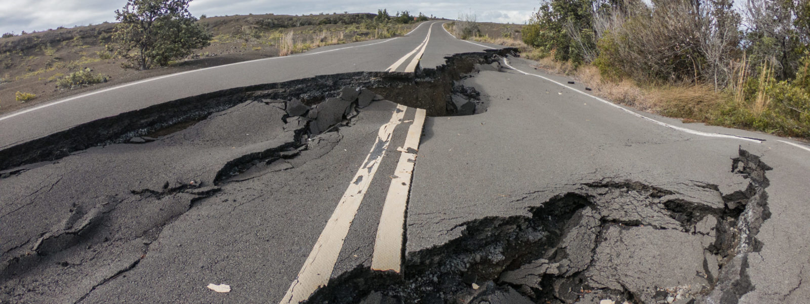 Cracked road from volcano activity in Volcano national park, Hawaii